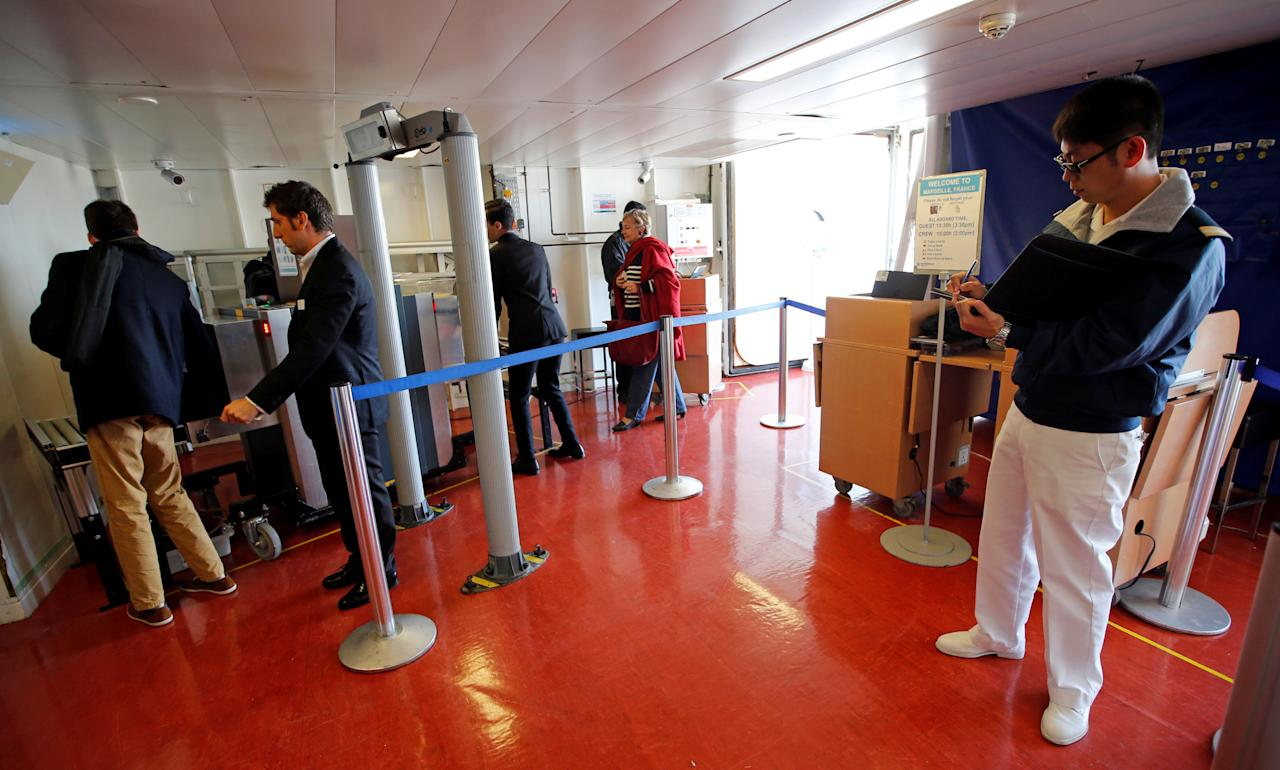 Security officers conduct a security check inside the Norwegian Epic cruise ship moored at the cruise terminal in Marseille, France, October 22, 2016.     REUTERS/Jean-Paul Pelissier