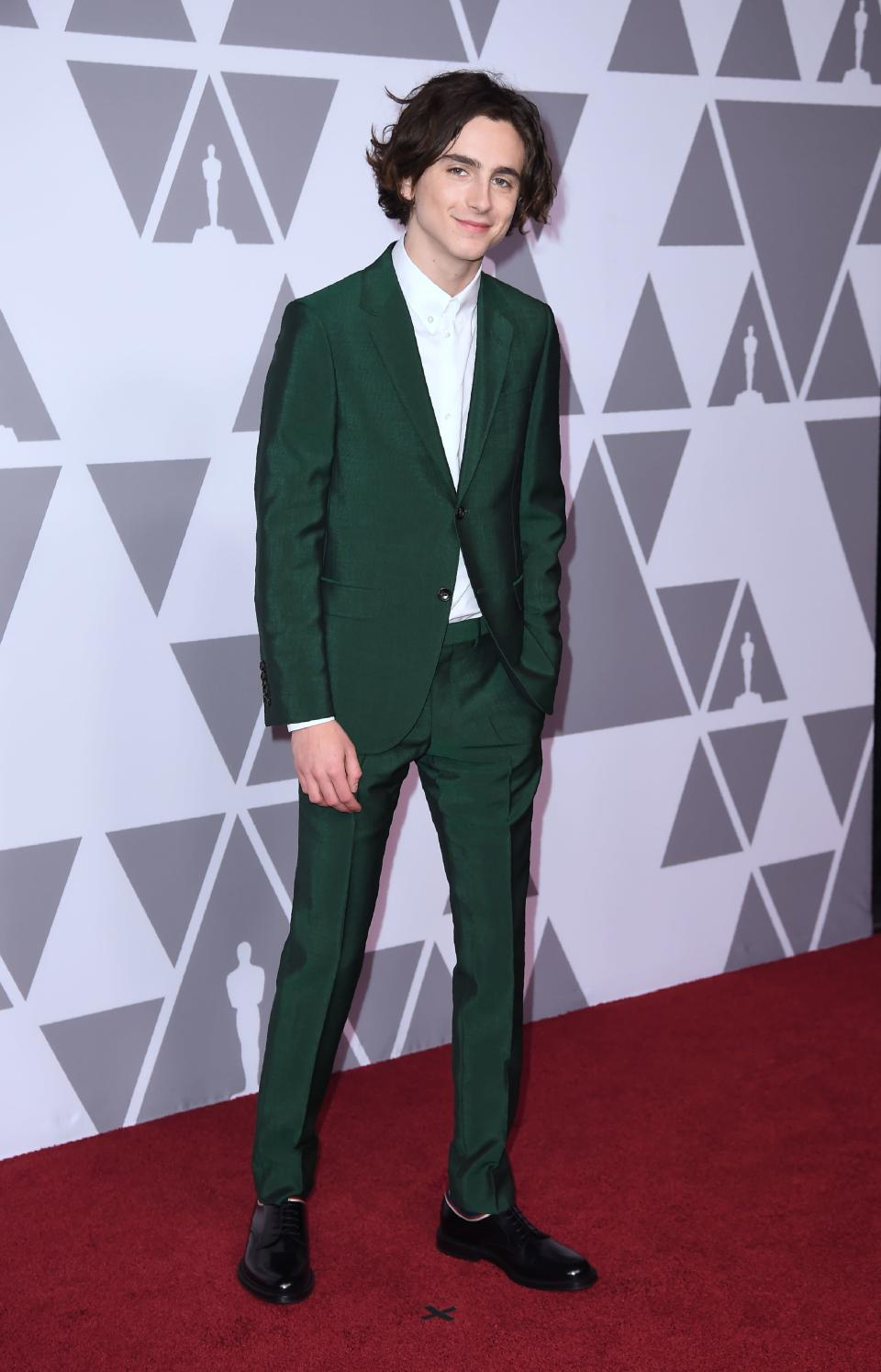 <p>The 'Ladybird' actor looked dashing in a green Gucci suit, sans tie. [Photo: Getty] </p>
