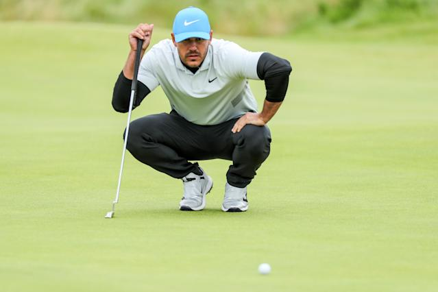 Brooks Koepka apparently didn't snub Tiger Woods on purpose. He just changed his phone number. (Getty Images)