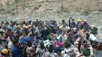 Emergency workers pull out more trapped men from a tunnel after a flood triggered by a piece of Himalayan glacier breaking off in northern India