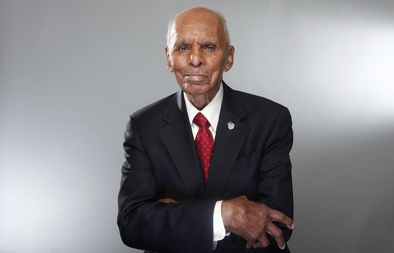 "In this Jan. 10, 2012 photo, Tuskegee airman Dr. Roscoe Brown poses for a portrait during the ""Red Tails"" press junket in New York. ""Red Tails,"" a film that chronicles the heroism of the Tuskegee Airmen, opens Friday, Jan. 20. (AP Photo/Carlo Allegri)"