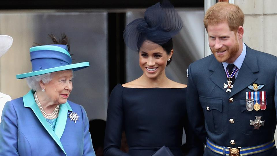 The Queen with grandson Prince Harry and his wife Meghan Markle