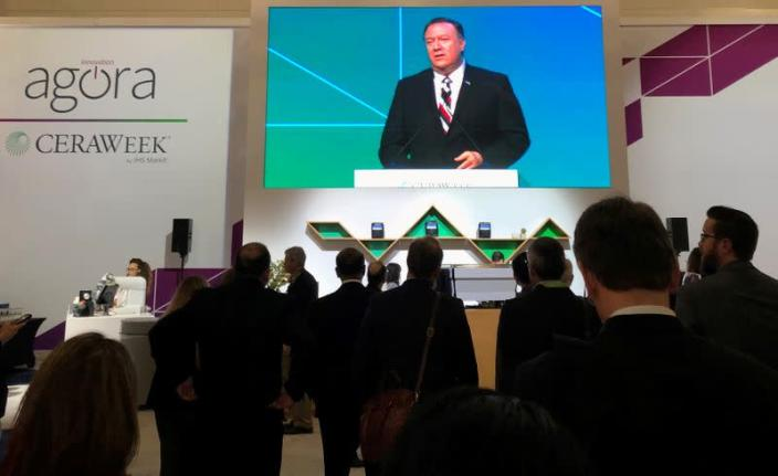 FILE PHOTO: Attendees at IHS Markit's CERAWeek conference watch the keynote address by U.S. Secretary of State Mike Pompeo from the George Brown Convention Center in Houston