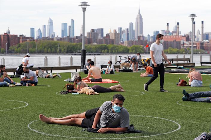 People relax in circles drawn to help social distancing at Domino Park in Brooklyn, New York. (Photo: ASSOCIATED PRESS)