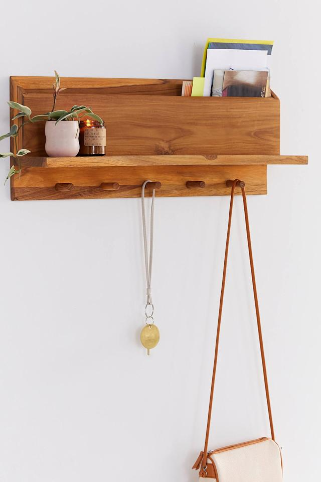 """<p>Hang your keys, bag, and even store your mail on this <a href=""""https://www.popsugar.com/buy/Takara-Entryway-Shelf-498196?p_name=Takara%20Entryway%20Shelf&retailer=urbanoutfitters.com&pid=498196&price=129&evar1=casa%3Auk&evar9=46719307&evar98=https%3A%2F%2Fwww.popsugar.com%2Fhome%2Fphoto-gallery%2F46719307%2Fimage%2F46719395%2FTakara-Entryway-Shelf&list1=shopping%2Corganization%2Capartments%2Chome%20organization&prop13=api&pdata=1"""" rel=""""nofollow"""" data-shoppable-link=""""1"""" target=""""_blank"""" class=""""ga-track"""" data-ga-category=""""Related"""" data-ga-label=""""https://www.urbanoutfitters.com/shop/takara-entryway-shelf?category=SEARCHRESULTS&amp;color=020"""" data-ga-action=""""In-Line Links"""">Takara Entryway Shelf</a> ($129).</p>"""