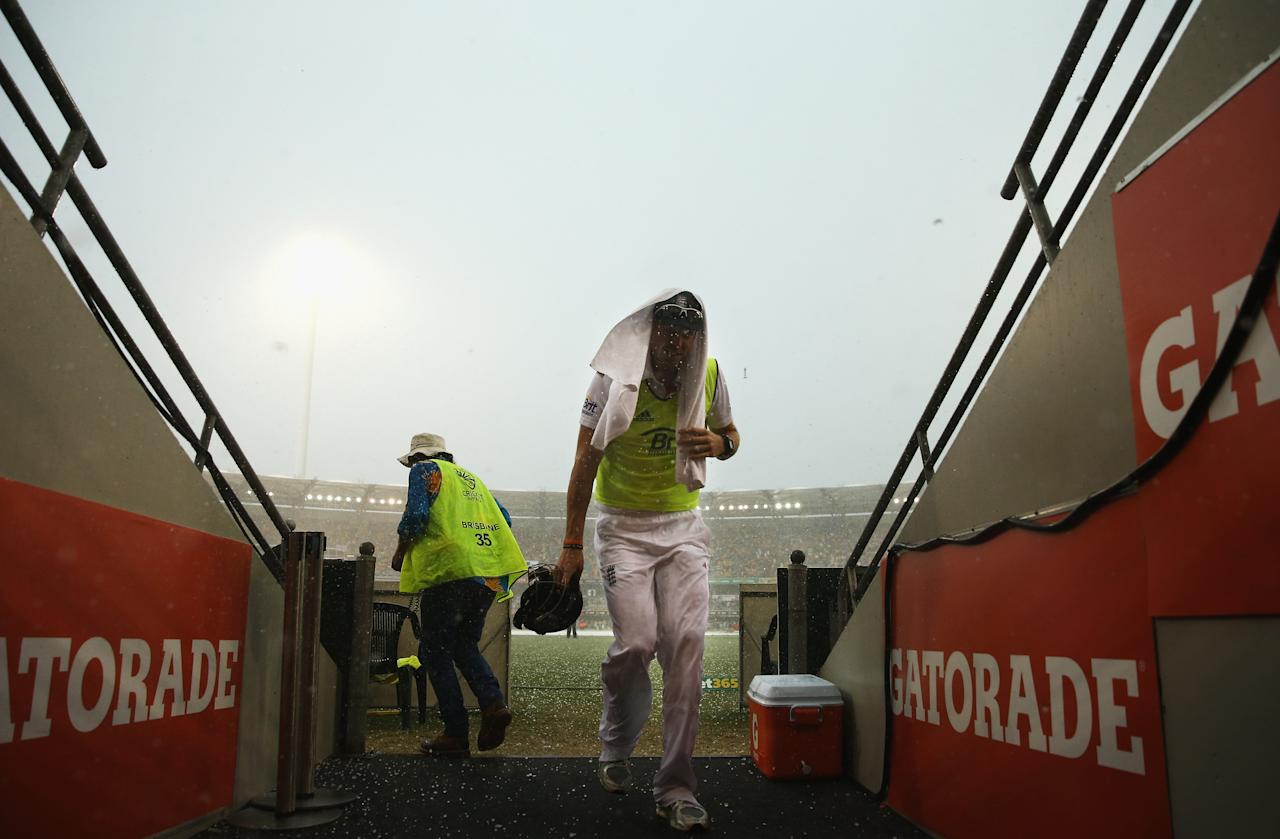 BRISBANE, AUSTRALIA - NOVEMBER 24: Boyd Rankin of England runs into the changeroom as a hail storm hits the Gabba during day four of the First Ashes Test match between Australia and England at The Gabba on November 24, 2013 in Brisbane, Australia.  (Photo by Ryan Pierse/Getty Images)