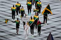 <p>TOKYO, JAPAN - JULY 23: Flag bearers Shelly-Ann Fraser-Pryce and Ricardo Brown of Team Jamaica take part in the Parade of Nations during the Opening Ceremony of the Tokyo 2020 Olympic Games at Olympic Stadium on July 23, 2021 in Tokyo, Japan. (Photo by Wei Zheng/CHINASPORTS/VCG via Getty Images)</p>