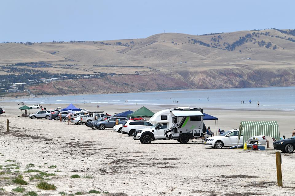 Cars are seen parked at Aldinga Beach in Adelaide on Tuesday. A heatwave spreading across Australia is expected to see parts of the nation swelter. Source: AAP Image/David Mariuz