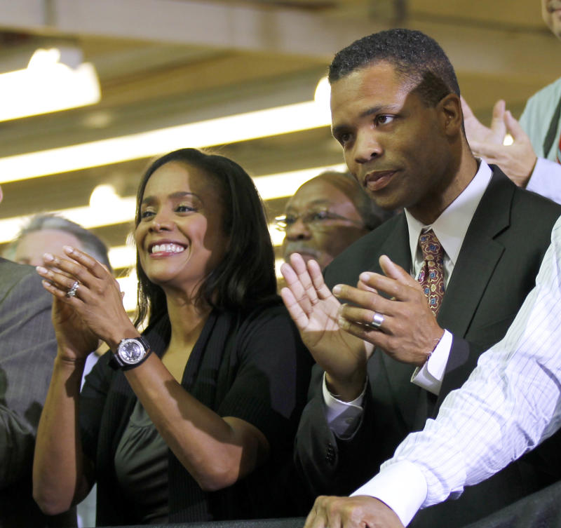 """FILE - In this Aug. 5, 2010 photo, Rep. Jesse Jackson Jr., D-Ill., right, and his wife Chicago Alderman Sandi Jackson, left, applaud as President Barack Obama is introduced at Ford Motor Company Chicago Assembly Plant.  Illinois Rep. Jesse Jackson Jr. says he's a """"public servant"""" not a """"perfect servant.""""  The Democrat tells The Associated Press that even as he's been dogged by links to disgraced former Gov. Rod Blagojevich and questions about his relationship with a female """"social acquaintance,"""" he's never deviated from his mission of bringing jobs to his Chicago area district. (AP Photo/Pablo Martinez Monsivais, File)"""