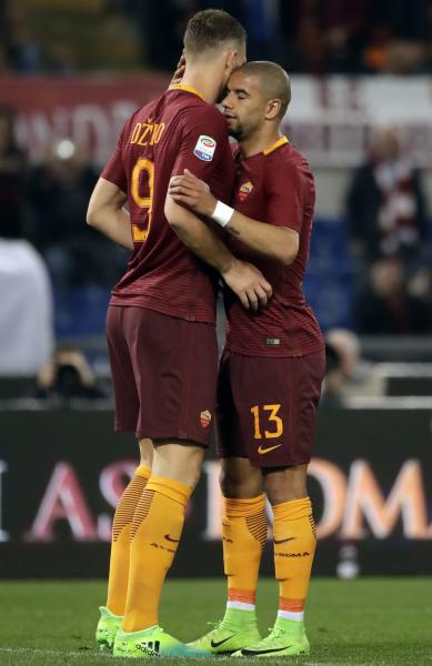 Roma's Edin Dzeko, left, celebrates with teammate Bruno Peres after scoring his side's second goal during a Serie A soccer match between Roma and Empoli, at the Rome Olympic stadium, Saturday, April 1, 2017. (AP Photo/Alessandra Tarantino)
