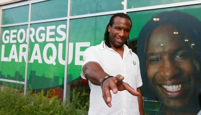 FILE PHOTO: Green Party Bourassa by-election candidate Laraque smiles following the opening of his new campaign office in Montreal