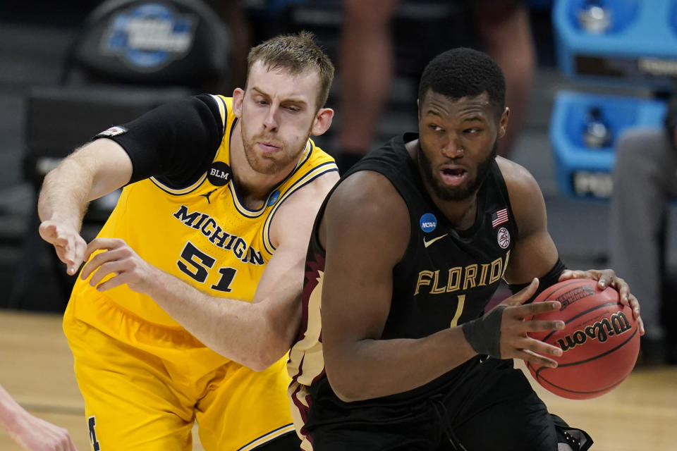Florida State forward RaiQuan Gray drives past Michigan forward Austin Davis (51) during the second half of a Sweet 16 game in the NCAA men's college basketball tournament at Bankers Life Fieldhouse, Sunday, March 28, 2021, in Indianapolis. (AP Photo/Jeff Roberson)
