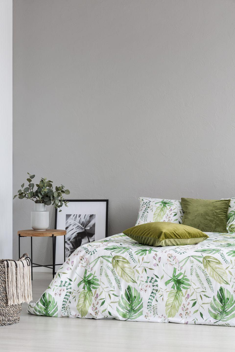 """<p>Interior designers predict that deep colors like navy blue and hunter green will be some of the <a href=""""https://www.goodhousekeeping.com/home/decorating-ideas/g34764482/paint-color-trends-2021/"""" rel=""""nofollow noopener"""" target=""""_blank"""" data-ylk=""""slk:top-trending colors of 2021"""" class=""""link rapid-noclick-resp"""">top-trending colors of 2021</a>. But just because they're darker shades doesn't mean they can't be brightened up for spring. """"I love how olive green is being used in paint, pillows, and upholstery,"""" says Mayer. """"It's a great example of a color that transitions well from spring and summer to cooler months."""" Pair the hue with lots of indoor plants for a serious celebration of spring. </p>"""