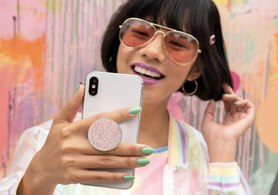 <p>This <span>PopSockets PopGrip with Swappable Top</span> ($15) is a useful accessory for taking selfies. </p>