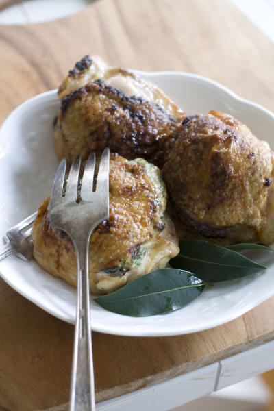 This Nov. 11, 2013 photo shows spinach stuffed chicken thighs in Concord, N.H. (AP Photo/Matthew Mead)