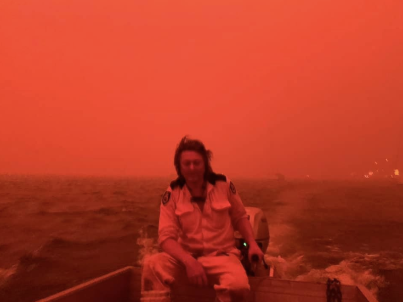 The sky went red as Ms Harvey and her friends Simon (pictured), and Karen were surrounded by flames. Source: Supplied