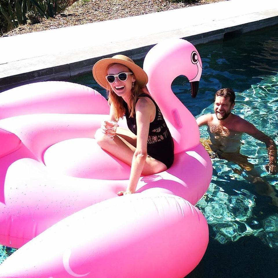 Diane Kruger matching her flamingo float with a glass of rosé, as one does.