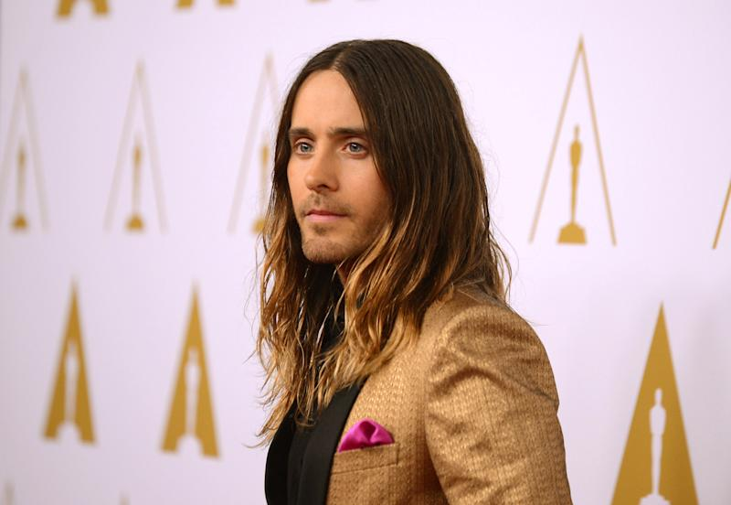 "FILE - In this Monday, Feb. 10, 2014 file photo, actor Jared Leto arrives at the 86th Oscars Nominees Luncheon, in Beverly Hills, Calif. Leto is nominated for an Academy Award for performance by an actor in a supporting role in the film, ""The Dallas Buyer's Club."" The key to making a red carpet splash is color; and men are getting more colorful like Leto at the nominees luncheon. (Photo by Jordan Strauss/Invision/AP)"