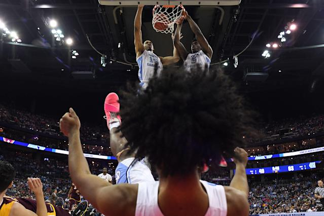 COLUMBUS, OH - MARCH 22: Garrison Brooks #15 and Nassir Little #5 of the North Carolina Tar Heels watch the ball go in as Coby White #2 falls to the floor against the Iona Gaels in the first round of the 2019 NCAA Men's Basketball Tournament held at Nationwide Arena on March 22, 2019 in Columbus, Ohio. (Photo by Jamie Schwaberow/NCAA Photos via Getty Images)