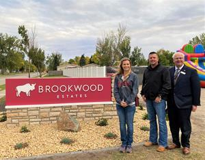 West Fargo City commissioner, Mandy George; Havepark Communities Divisional Vice President, Sean King; and West Fargo City Mayor, Bernie Dardis pose in front of the newly installed Brookwood Estates monument sign.