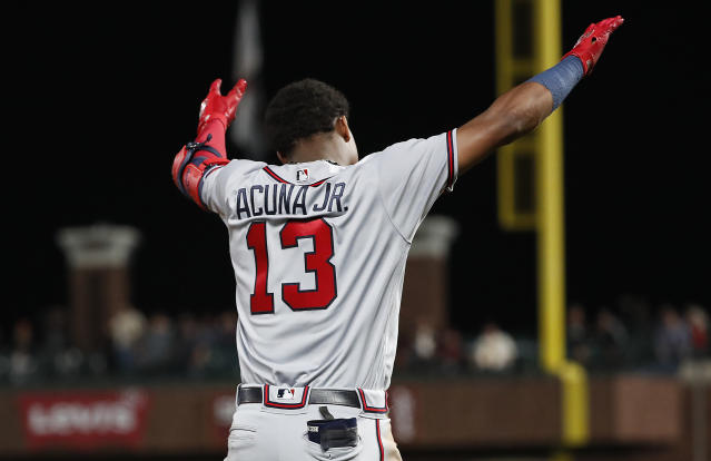 Atlanta Braves' Ronald Acuna Jr. (13) gestures after hitting a triple against the San Francisco Giants during the fifth inning of a baseball game in San Francisco, Tuesday, Sept. 11, 2018. (AP Photo/Tony Avelar)