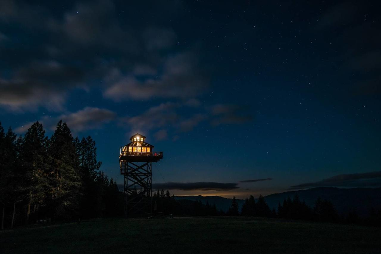 """<p>This lookout in Oregon's Umpqua National Forest is more than 40 feet off the ground, getting you that much closer to the stars themselves. About four hours south of <a href=""""https://www.cntraveler.com/destinations/portland-oregon?mbid=synd_yahoo_rss"""" target=""""_blank"""">Portland</a>, this off-the-grid, one-room home has spring water and a small, solar-powered electricity system, as well as a rather rustic bathroom setup (there's a pit toilet a short walk from the tower). Far from civilization, the lookout's deck is a great place to spot shooting stars, but the wood-fired, spring-fed hot tub isn't a bad place to relax after sunset, either. Just know that <a href=""""https://airbnb.pvxt.net/XjBLX"""" rel=""""nofollow"""" target=""""_blank"""">this home goes fast on Airbnb</a>—in 2020, bookings for April to July open March 8 at 9 a.m. PDT, while fall reservations will be available starting June 7 at 9 a.m. PDT. Up to four guests can fit, so be sure to set an alarm and have your night owl friends on speed dial when it comes time to book.</p> <p><strong>Book Now:</strong> <a href=""""https://airbnb.pvxt.net/XjBLX"""" rel=""""nofollow"""" target=""""_blank"""">From $175 per night, airbnb.com</a></p>"""