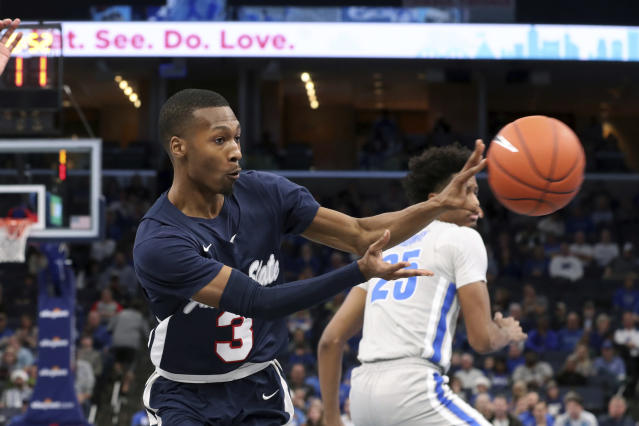 Jackson State guard Jonas James (3) passes the ball to his teammate in the first half of an NCAA college basketball game against Memphis Saturday, Dec. 21, 2019, in Memphis, Tenn. (AP Photo/Karen Pulfer Focht)