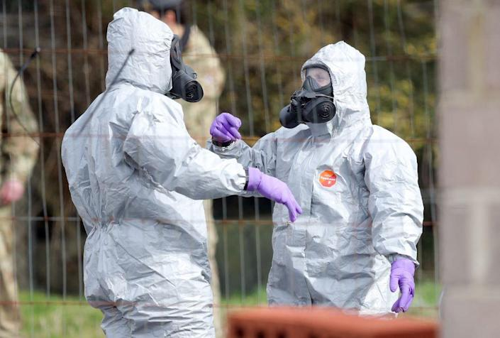Soldiers in protective gear carry out investigations following the Salisbury poisonings (PA)