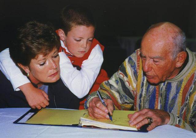 In this Oct. 12, 2000, file photo, provided by the University of Tennessee, Tyler Summitt, center, holds onto his mother, Tennessee women's basketball coach Pat Summitt, as she talks with former NBA coach Jack Ramsay at the Basketball Hall of Fame in Springfield, Mass. Ramsay, a Hall of Fame coach who led the Portland Trail Blazers to the 1977 NBA championship before he became one of the league's most respected broadcasters, has died following a long battle with cancer. He was 89. (AP Photo/University of Tennessee Sports Information, Debby Jennings)