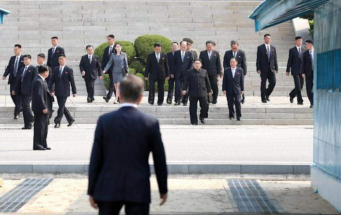 South Korea's President Moon Jae-in (front) waits before the Military Demarcation Line for North Korea's leader Kim Jong Un (centre R) ahead of the inter-Korean summit at the truce village of Panmunjom (AFP Photo/Korea Summit Press Pool)