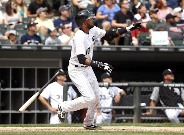 Chicago White Sox's Alexei Ramirez watches his two-run home run off Minnesota Twins starting pitcher Kyle Gibson, also scoring Gordon Beckham, during the fifth inning of a baseball game Friday, Aug. 9, 2013, in Chicago. (AP Photo/Charles Rex Arbogast)