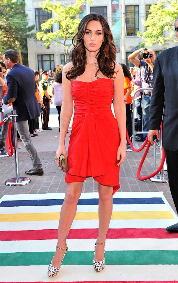 """Meanwhile, at the Toronto International Film Festival premiere of """"Friends with Kids,"""" Megan Fox turned heads in a strapless red Thakoon Resort 2012 mini, Brian Atwood """"Zenith"""" heels, and a David Webb cocktail ring. George Pimentel/<a href=""""http://www.wireimage.com"""" target=""""new"""">WireImage.com</a> - September 9, 2011"""