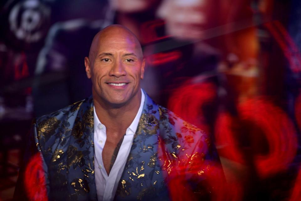 """HOLLYWOOD, CALIFORNIA - DECEMBER 09: (EDITORS NOTE: This image has been shot with a double exposure.) Dwayne Johnson attends the premiere of Sony Pictures' """"Jumanji: The Next Level"""" at TCL Chinese Theatre on December 09, 2019 in Hollywood, California. (Photo by Matt Winkelmeyer/FilmMagic)"""