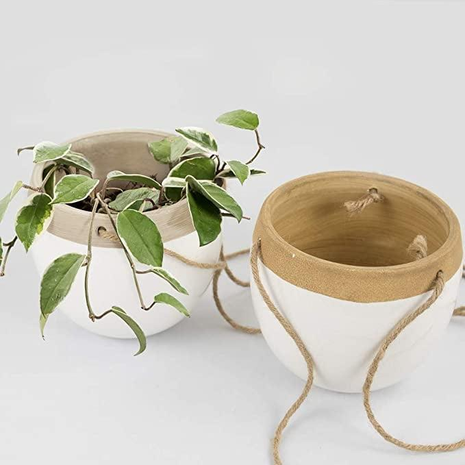 <p>You can't go wrong with these classic <span>Modern Ceramic Hanging Planters with Jute Rope, Set of 2</span> ($30).</p>