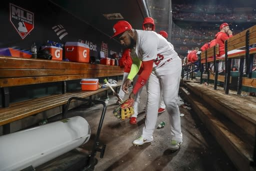 St. Louis Cardinals' Marcell Ozuna warms up during the seventh inning of Game 1 of the baseball National League Championship Series against the Washington Nationals Friday, Oct. 11, 2019, in St. Louis. (AP Photo/Jeff Roberson)