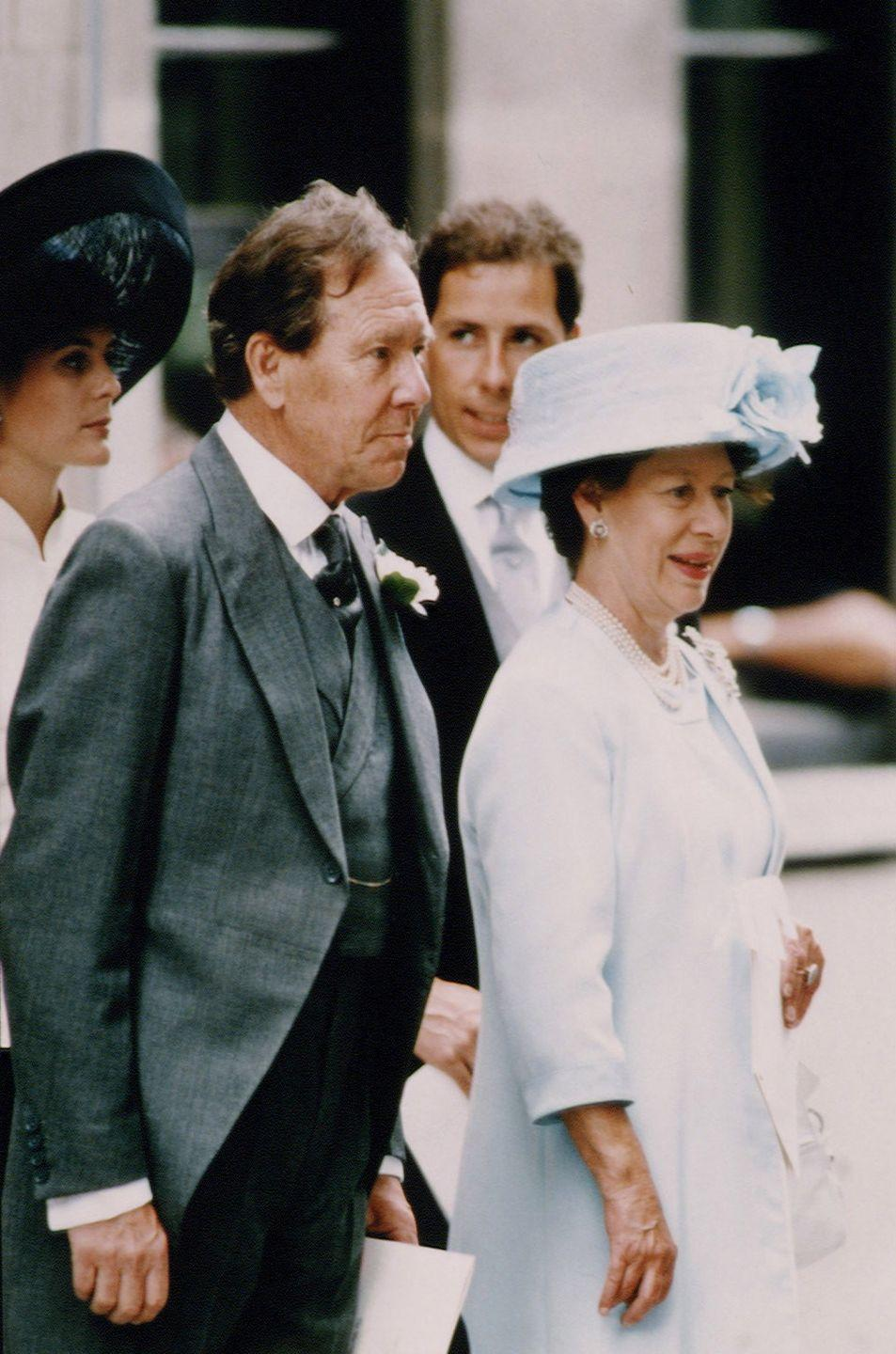 """<p>For her daughter Sarah's wedding, Princess Margaret wore a pale blue hat and dress. Here she is with her ex-husband, Lord Snowdon.</p><p><strong><a href=""""https://www.townandcountrymag.com/society/news/a9255/princess-margaret-lord-snowdon-relationship/"""" rel=""""nofollow noopener"""" target=""""_blank"""" data-ylk=""""slk:More: The True Story of Princess Margaret and Antony Armstrong-Jones's Love Affair"""" class=""""link rapid-noclick-resp"""">More: The True Story of Princess Margaret and Antony Armstrong-Jones's Love Affair</a></strong><br></p>"""
