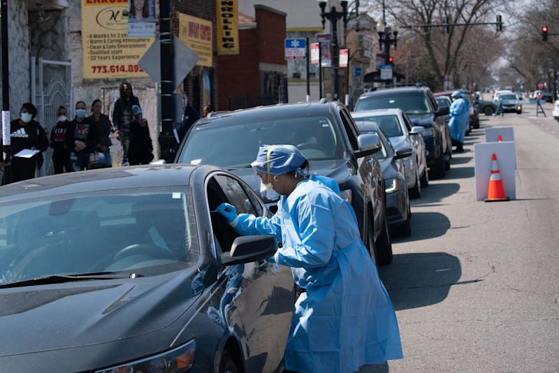 People wait in line in their cars to get tested for COVID-19 at Roseland Community Hospital on April 3, 2020. (E. Jason Wambsgans/Chicago Tribune/Tribune News Service via Getty Images)