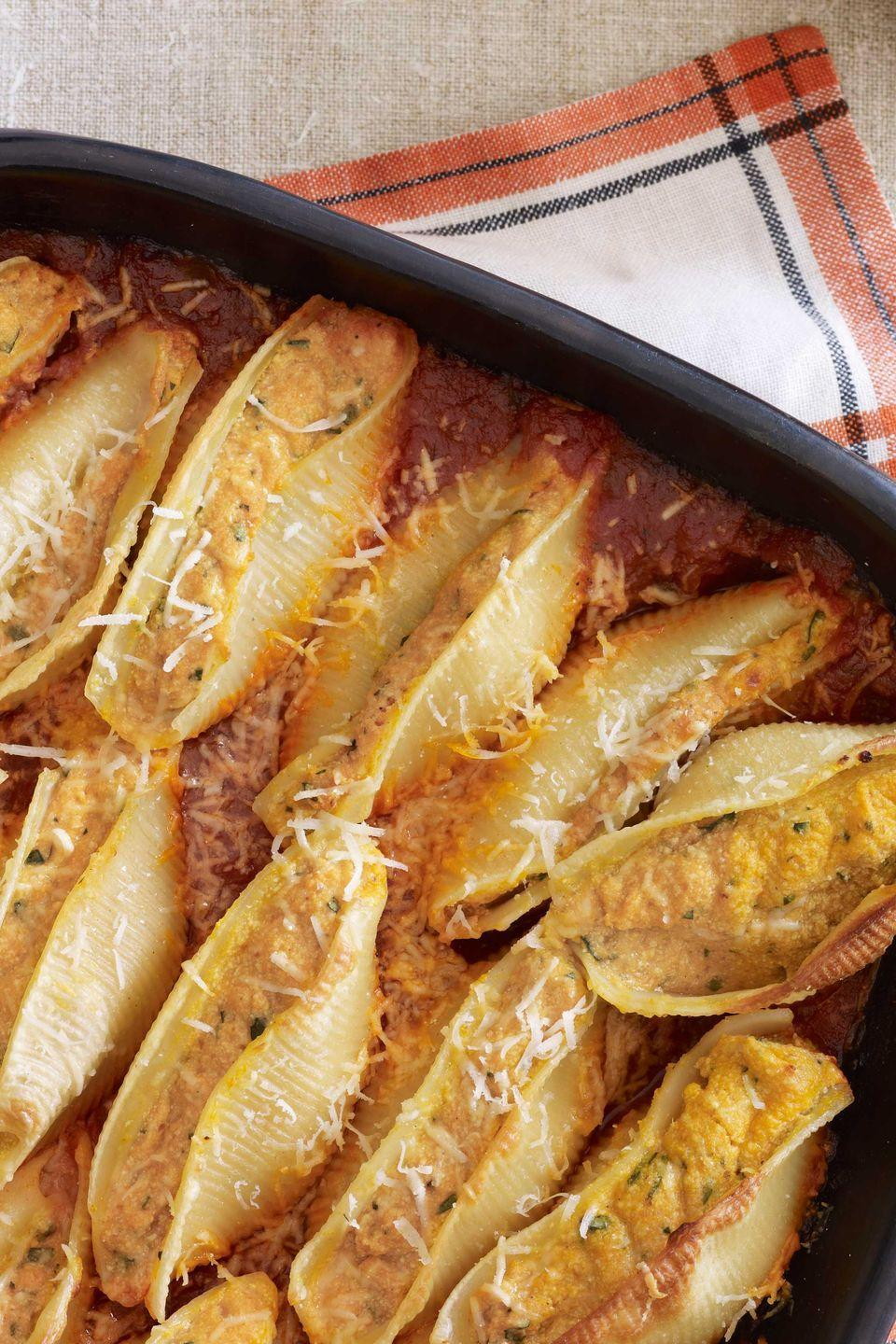 """<p>By incorporating pumpkin, this recipe requires less cheese than is typically used to stuff shells, but keeps all the delicious flavor.</p><p><strong><a href=""""https://www.countryliving.com/food-drinks/recipes/a3921/pumpkin-ricotta-stuffed-shells-recipe-clv1011/"""" rel=""""nofollow noopener"""" target=""""_blank"""" data-ylk=""""slk:Get the recipe"""" class=""""link rapid-noclick-resp"""">Get the recipe</a>.</strong><br></p><p><a class=""""link rapid-noclick-resp"""" href=""""https://www.amazon.com/Nordic-Ware-Natural-Aluminum-Commercial/dp/B0049C2S32/?tag=syn-yahoo-20&ascsubtag=%5Bartid%7C10050.g.619%5Bsrc%7Cyahoo-us"""" rel=""""nofollow noopener"""" target=""""_blank"""" data-ylk=""""slk:SHOP BAKING SHEETS"""">SHOP BAKING SHEETS</a></p>"""