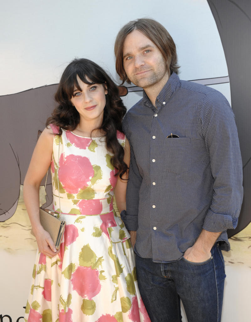 """FILE - In this July 10, 2011 file photo, actress Zooey Deschanel, left, and her husband, musician Ben Gibbard arrive at the premiere of the animated feature film """"Winnie the Pooh"""" at The Walt Disney Studios in Burbank, Calif. Deschanel filed for divorce from Death Cab for Cutie lead singer Ben Gibbard on Dec. 27 in Los Angeles. (AP Photo/Dan Steinberg, file)"""