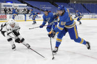 Los Angeles Kings' Mikey Anderson (44) attempts to block a shot from St. Louis Blues' Mike Hoffman (68) during the second period of an NHL hockey game Saturday, Jan. 23, 2021, in St. Louis. (AP Photo/Joe Puetz)