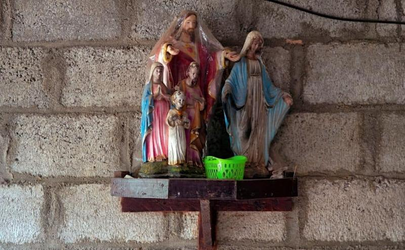"Statues of Mary and Jesus are seen inside the unfinished house of Lahiru Prasanga Fernando, 34, and his wife Diliini Sangeewani, 34, in Negombo, Sri Lanka, May 1, 2019. The couple were killed during Easter Sunday bombings at St. Sebastian Church. ""They had been married for more than 15 years and were so happy together. They were childless but treated this house as their kid. They were building it slowly for the last few years. Now they've left me alone in this house,"" said Sudarshni Fernando, mother of Lahiru. REUTERS/Danish Siddiqui SEARCH ""SIDDIQUI GOMEZ"" FOR THIS STORY. SEARCH ""WIDER IMAGE"" FOR ALL STORIES."