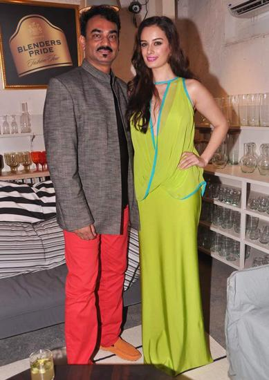 Wendell Rodricks looked to musician Cole Porter for inspiration. Evelyn Sharma wore a resort-appropriate look in a lime green Wendell Rodricks gown.