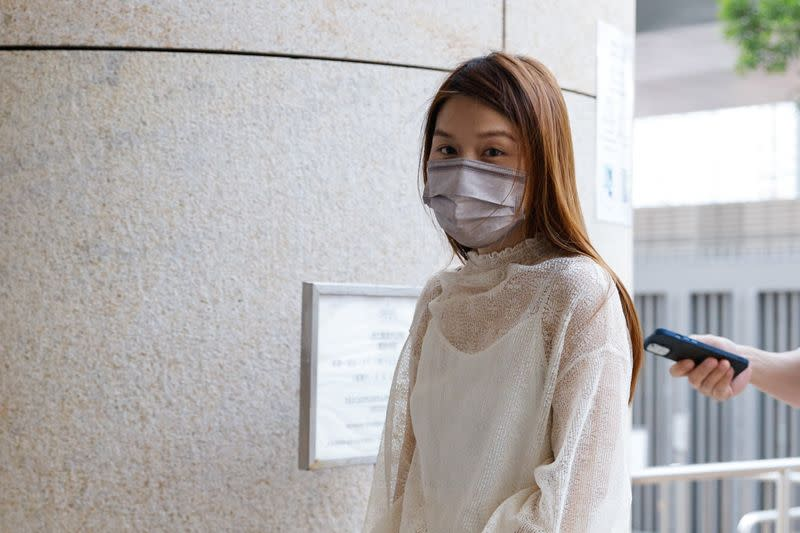 Pro-democracy activist Clarisse Yeung Suet-ying, one of the 47 pro-democracy activists charged with conspiracy to commit subversion under the national security law, arrives West Kowloon Magistrates's Courts building, in Hong Kong