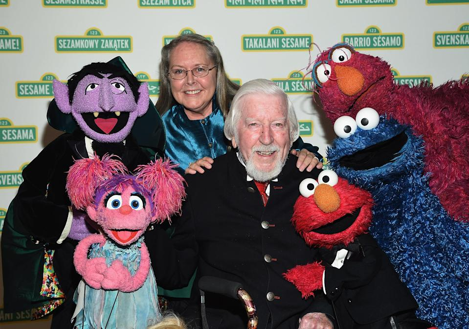 Spinney with his wife, Debra, at a <em>Sesame Street</em> event in 2017. (Photo: Mike Coppola/WireImage)