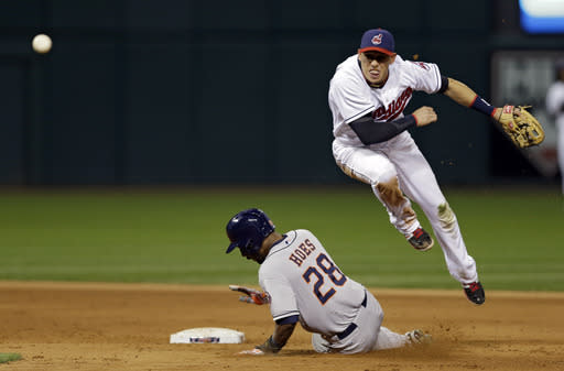 Cleveland Indians shortstop Asdrubal Cabrera, right, throws over Houston Astros' L.J. Hoes (28) to complete a double play on Jonathan Villar to end the top of the fifth inning in a baseball game on Friday, Sept. 20, 2013, in Cleveland. (AP Photo/Mark Duncan)