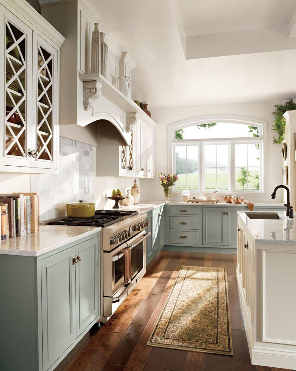 "<p>Pair <a href=""https://www.housebeautiful.com/design-inspiration/a6472/two-toned-kitchen-cabinets/"" rel=""nofollow noopener"" target=""_blank"" data-ylk=""slk:light upper cabinets with a darker base"" class=""link rapid-noclick-resp"">light upper cabinets with a darker base</a> so the room still feels light and spacious. Pro tip: Add glass doors and it'll feel even more open.</p>"