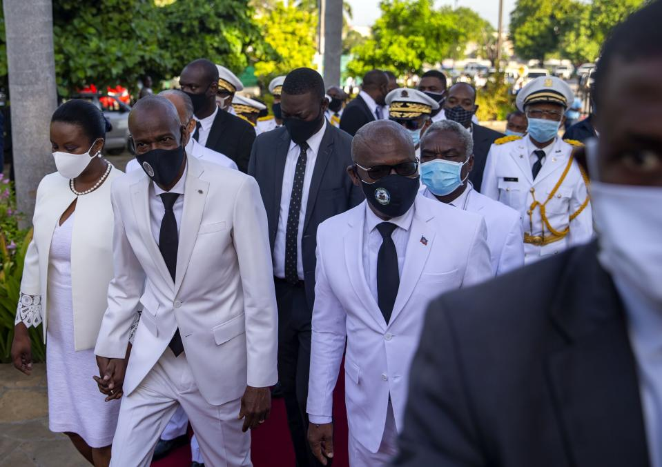 FILE - Haiti's President Jovenel Moïse, center left, holds hands with his wife Martine, as he walks with new prime minister Joseph Jouthe, right, before laying flowers to mark the death anniversary of revolutionary leader Jean-Jacques Dessalines, in Port-au-Prince, Haiti, in this Saturday, Oct. 17, 2020, file photo. Haitian Prime Minister Joseph Jouthe announced early Wednesday, April 14, 2021, that he has resigned as the country faces a spike in killings and kidnappings and prepares for an upcoming constitutional referendum and general election later this year. (AP Photo/Dieu Nalio Chery, File)