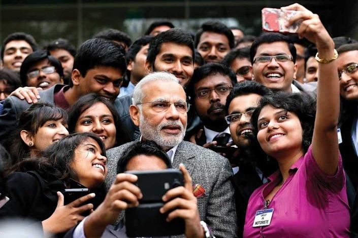 Prime Minister Narendra Modi takes a selfie with Indian employees during a visit to the Airbus facility in Toulouse, France, 2015