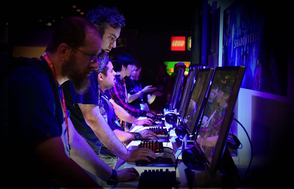 "Gaming fans play ""Shadowverse"" from Cygames at the Twitch Booth on day two of E3 2017, the three day Electronic Entertainment Expo at the Los Angeles Convention Center in Los Angeles, California on June 14, 2017. / AFP PHOTO / FREDERIC J. BROWN (Photo credit should read FREDERIC J. BROWN/AFP/Getty Images)"