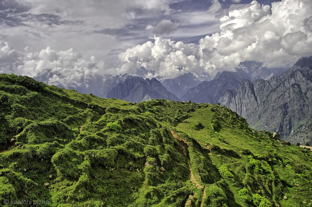 <p>A five-hour drive from Dehradun will bring you to the incredibly scenic hill station of Auli. One of the lesser know Located at 2,800 metres above sea level, Auli has stunning views of the snow-capped Himalayan range, rolling apple orchards, and forests of oak and deodar. A lesser know hill station, it is a great spot for trekkers looking to explore the Garhwal Himlayas. One of these is a three-kilometre trek to Gurso Bugyal, located 3,380 metres above sea level. Auli is also a popular destination with skiers, being rated one of the best in the country.<br />Photograph: Raghavan Prabhu/Flickr </p>